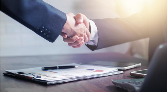 two-businessmen-shake-hands-to-celebrate-a-business-deal-free-photo
