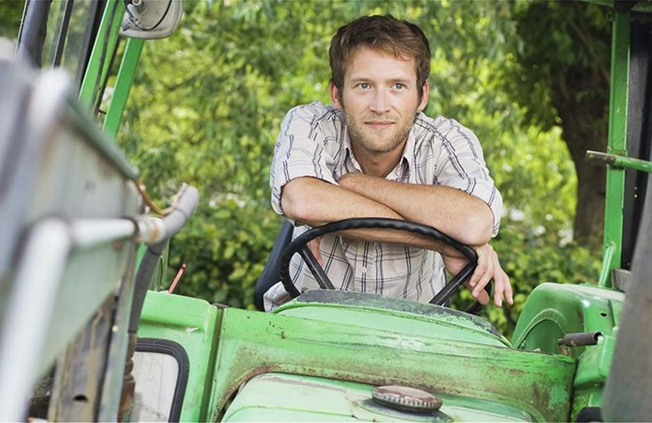 young-farmer-in-tractor-cab-photo-WestEnd61-REX-Shutterstock